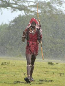 "A Maasai warrior (""moran"" or ""olmurrani"") in the heavy rains"